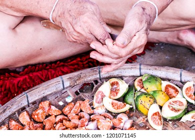 Cutting red Betel nut fresh betel palm on wooden tray