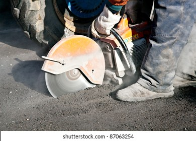 Cutting road works with cut off saw