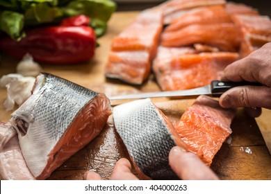 Cutting salmon fresh fish for dinner