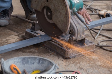 Cutting Steel with grinder. Sparks while grinding iron