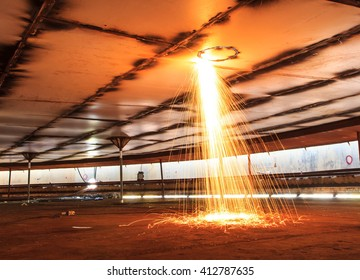 Cutting steel roof storage tank sparks heat  confined.