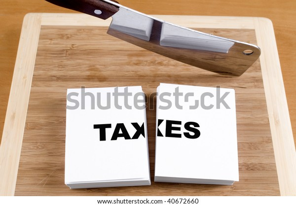 Cutting Taxes with a Cleaver and Cutting Board.