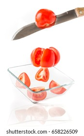 Cutting tomatoes. A tomato salad. Preparation of vegetable salad.