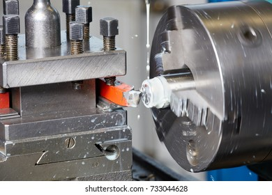 Cutting tool at steel piece working on lather machine