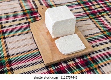 Cutting traditional bulgarian salty white cheese with a knife. First person point of view concept.