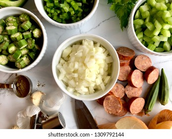Cutting up vegetables and andouille sausage for gumbo