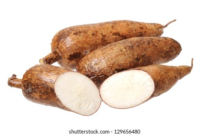 cutting and whole manioc (cassava) isolated on white background