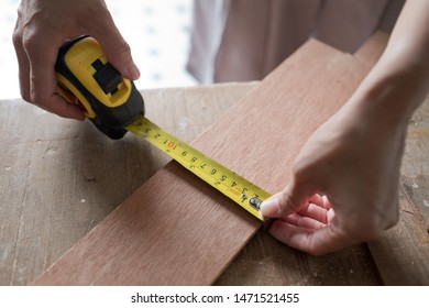 cutting wood for building, Wood drill, carpenter, worker