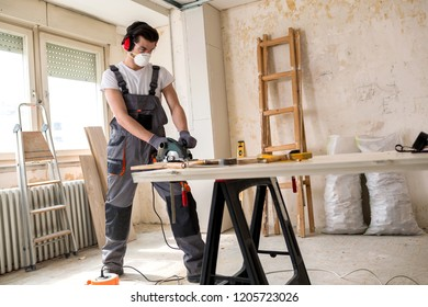 Cutting of a wooden door using electric circular saw for precise edge definition