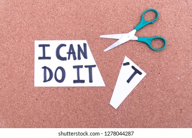 Cutting the word in paper note I can't do it to read I can do, concept for self belief, positive attitude and motivation.