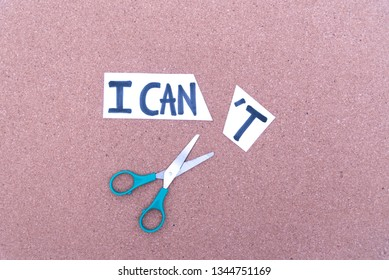 Cutting the word in paper note I can't to read I can, concept for self belief, positive attitude and motivation.