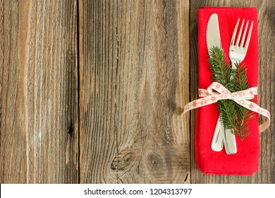 Cuttlery with decoration on wooden table.Christmas background.