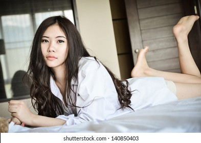 Cuty asian girl on bed
