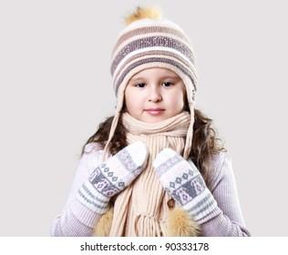 Cuty little girl in winter wear happy about new year