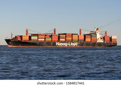 CUXHAVEN, GERMANY - OCTOBER 29, 2019: Hapag-Lloyd container ship WASHINGTON EXPRESS on the river Elbe. Hapag-Lloyd AG is a transnational German-based transportation company.
