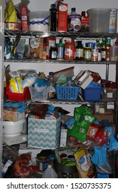 Cuyahoga Falls, OH/USA - October 1, 2019: Kitchen Prepper Pantry that is Messy and Needs Organized