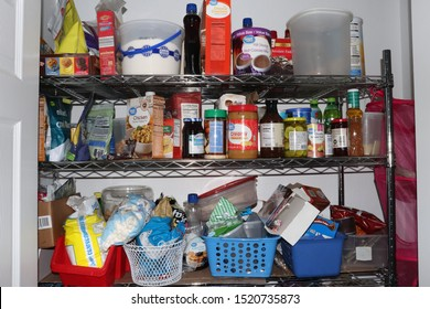 Cuyahoga Falls, OH/USA - October 1, 2019: Messy Prepper Pantry full of too much junk food