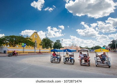 Cuzama, Mexico - January 17, 2017: Bicitaxis waiting for tourists
