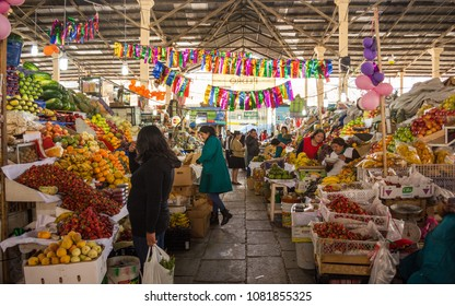 Cuzco, Cusco / Peru - June 6 2017: interior of San Pedro market with peruvians selling and buying fresh fruits and vegetables, eating and walking, at noon