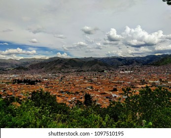Cuzco / Cusco, Peru - Looking down from hillside; view of mountain range and incoming cloudy weather (12k+ ft. above sea level)