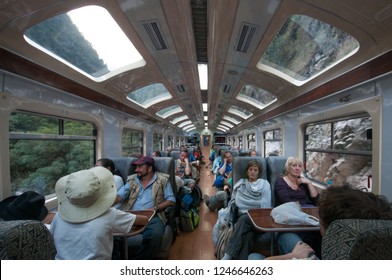 Cuzco, Peru - August 19 2011: Inside a train and passengers from Macchu Pichu to Cuzco