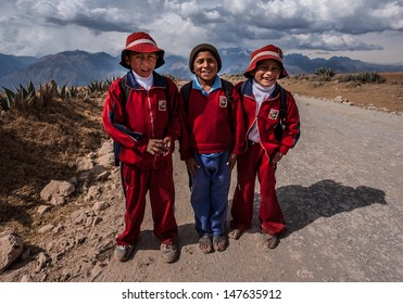 CUZCO, PERU CIRCA 2012: Portrait of not identified 10 years boys in traditional school dresses circa 2012 in Cuzco, Peru. Some children have to walk 2 hours a day for to go school in Peruvian mountain