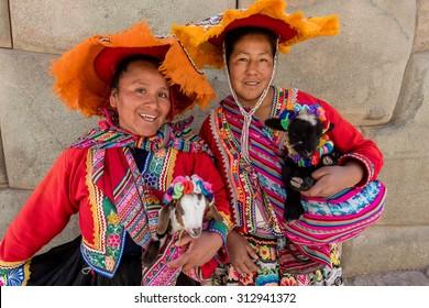 CUZCO, PERU - CIRCA 2015: Two unidentified women with traditional andean clothes circa 2015 in Cuzco, Peru.