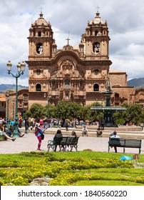 Cuzco, Peru - March 28 2019: Catholic church on main square Plaza de Armas in Cusco or Cuzco town, Peru