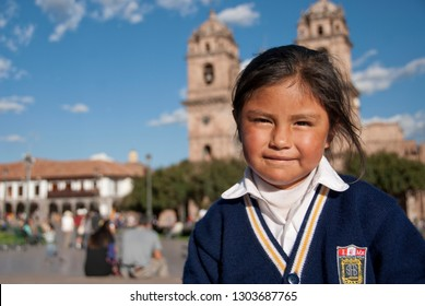 CUZCO, PERU - MAY 7 2010: Unidentified Peruvian school girl poses for a photo at Plaza de Armas in Cuzco, Peru. Peruvian kids often have to fend for themselves after school.