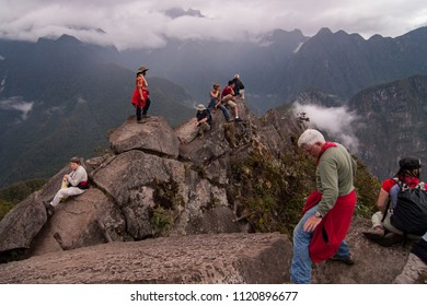 Cuzco, Peru - October 20 2008: The visitors climb up to the peak of Huayna Picchu to wait for the sunrise over Machu Picchu.