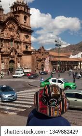 CUZCO-PERU, JUNE 5, 2015: tourist resting near the cathedral of Cusco city, Peru, on June 5, 2015