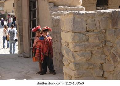 Cuzco/Peru-August 27, 2016: Peruvian Inca kids in Ollantaytambo archaeological site, Urubamba, Peru