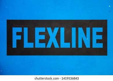 A Cyan Background FLEXOLINE Plate