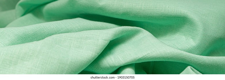 Cyan fabric background. Green fabric background. Cyan linen background. Banner ad template. Advertising banner