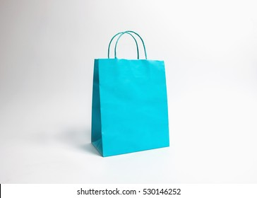 Cyan paper bags isolated on white background