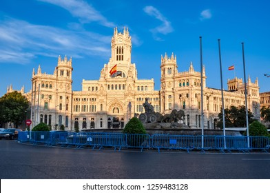 Cybele palace and fountain on Cibeles square at sunset, Madrid, Spain