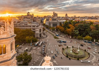 From the Cybele Palace the skyline of Madrid, Spain. View of the sunset in the Spanish capital city more tourist and visited of Europe with new and old buildings