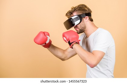 Cyber coach online training. Explore cyber space. Augmented 3D world. Cyber sportsman boxing gloves. Man play game in VR glasses. Cyber sport concept. Man boxer virtual reality headset simulation.
