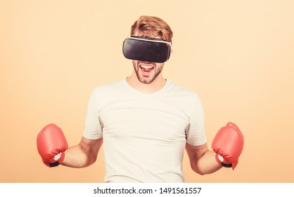 Cyber coach online training. Explore cyber space. Cyber sportsman boxing gloves. Man play game in VR glasses. Cyber sport concept. Augmented 3D world. Man boxer virtual reality headset simulation.