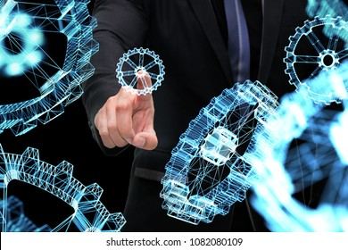 Cyber communication and robotic trend , Industrial 4.0 Cyber Physical Systems technology concept. ??Business man point finger and 3d rendering gears on black background.