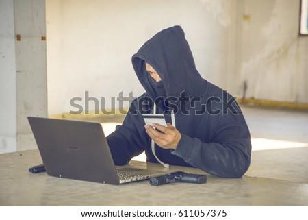 Cyber Criminal Stolen Credit Card Laptop Stock Photo (Edit