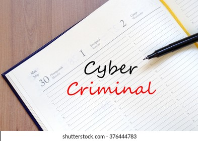 Cyber criminal text concept write on notebook with pen