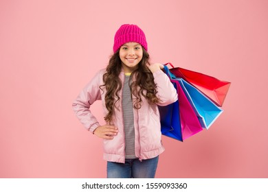 Cyber Monday is back. Small child enjoy Cyber Monday shopping. Happy girl carry paper bags. Cyber Monday sale. Cyber Monday deals and discounts. Buy more to save more.