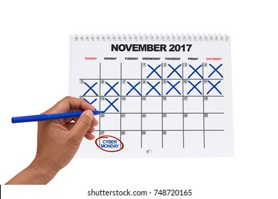 Cyber Monday countdown November 2017 calendar hand crossing out dates (two weeks to go) white background