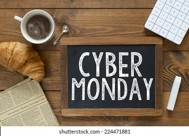Cyber monday handwritten with white chalk on a blackboard on a wooden background