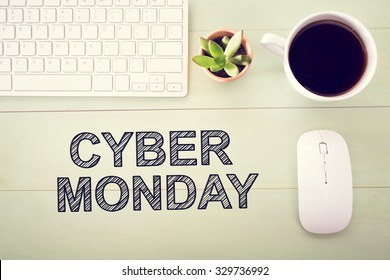 Cyber Monday message with workstation on a light green wooden desk