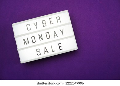 cyber monday sale flat lay top view on purple background