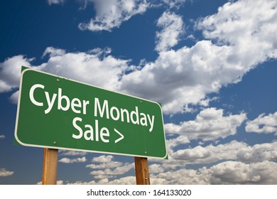 Cyber Monday Sale Green Road Sign with Dramatic Clouds and Sky.