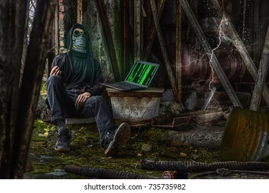 Cyber punk cosplay scene with man, look like cyber junkie (wire from laptop to hand) of postapocalyptic, destructed and radioactive future world. HDR