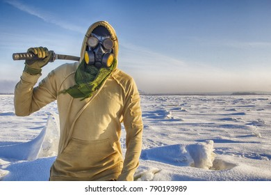 Cyber punk or post apocalypse warrior in goggles, gas mask, with japan sword in front of snow desert. HDR image